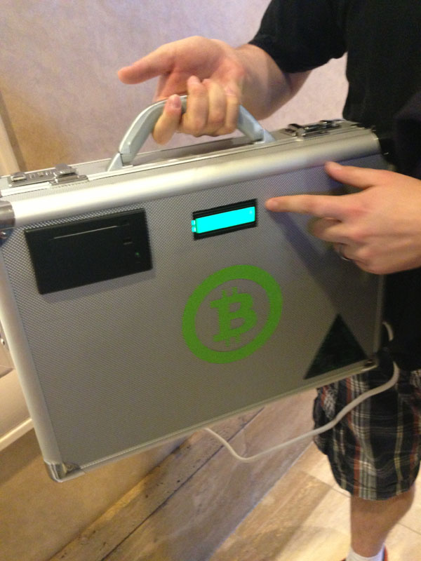 Bitcoin Briefcase Converts… hold on I have some more quarters here